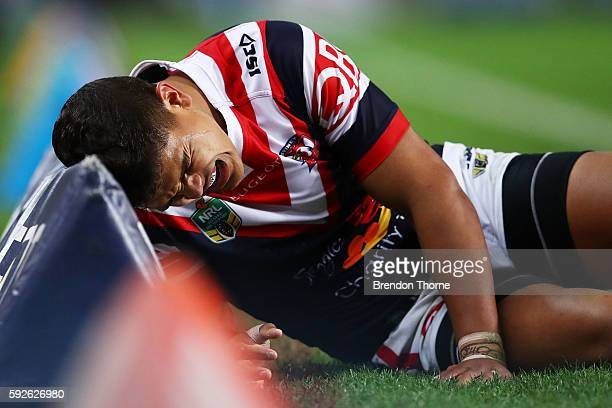 Latrell Mitchell of the Roosters shows signs of discomfort during the round 24 NRL match between the Sydney Roosters and the St George Illawarra...