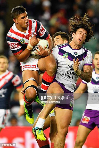 Latrell Mitchell of the Roosters takes a high ball during the round 14 NRL match between the Sydney Roosters and the Melbourne Storm at Allianz...