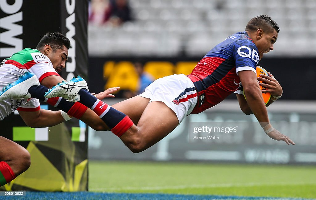 Latrell Mitchell of the Sydney Roosters scores a try during the 2016 Auckland Nines match between the Sydney Roosters and the South Sydney Rabbitohs at Eden Park on February 6, 2016 in Auckland, New Zealand.