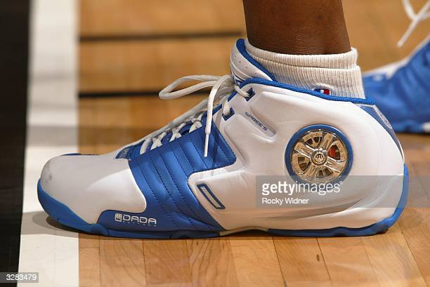Latrell Sprewell of the Minnesota Timberwolves shows off his shoes before the Timberwolves take on the Sacrmento Kings at Arco Arena on April 8 2004...