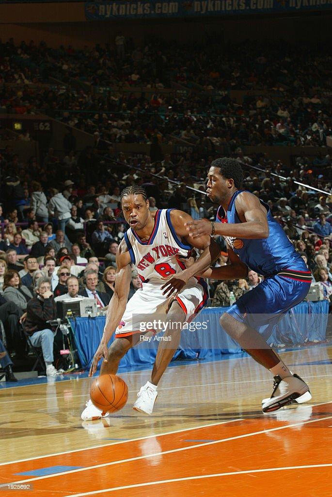 Latrell Sprewell #8 of the New York Knicks dribbles against John Salmons #7 of the Philadelphia 76ers on April 11, 2003 at Madison Square Garden in New York, New York.