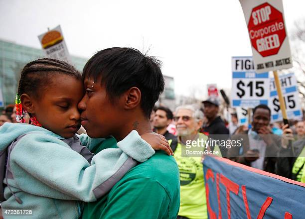 Latrese Williams of Dedham snuggled with her daughter Desirae Shealey at a rally against income inequality in Boston on April 14 2015