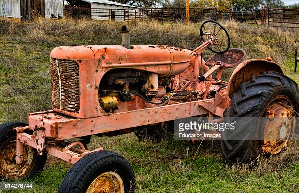 Latrobe California small farming town with old tractor in field
