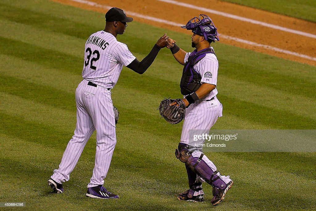 <a gi-track='captionPersonalityLinkClicked' href=/galleries/search?phrase=LaTroy+Hawkins&family=editorial&specificpeople=204722 ng-click='$event.stopPropagation()'>LaTroy Hawkins</a> #32 of the Colorado Rockies celebrates with catcher <a gi-track='captionPersonalityLinkClicked' href=/galleries/search?phrase=Wilin+Rosario&family=editorial&specificpeople=5734314 ng-click='$event.stopPropagation()'>Wilin Rosario</a> #20 after recording his 19th save of the season as the Rockies defeated the Kansas City Royals 5-2 at Coors Field on August 20, 2014 in Denver, Colorado.