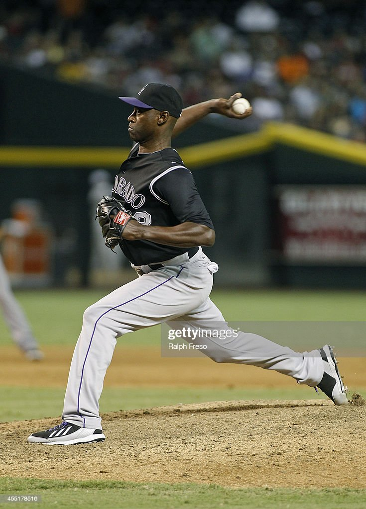 LaTroy Hawkins of the Colorado Rockies delivers a pitch against the Arizona Diamondbacks during the ninth inning of a MLB game at Chase Field on...