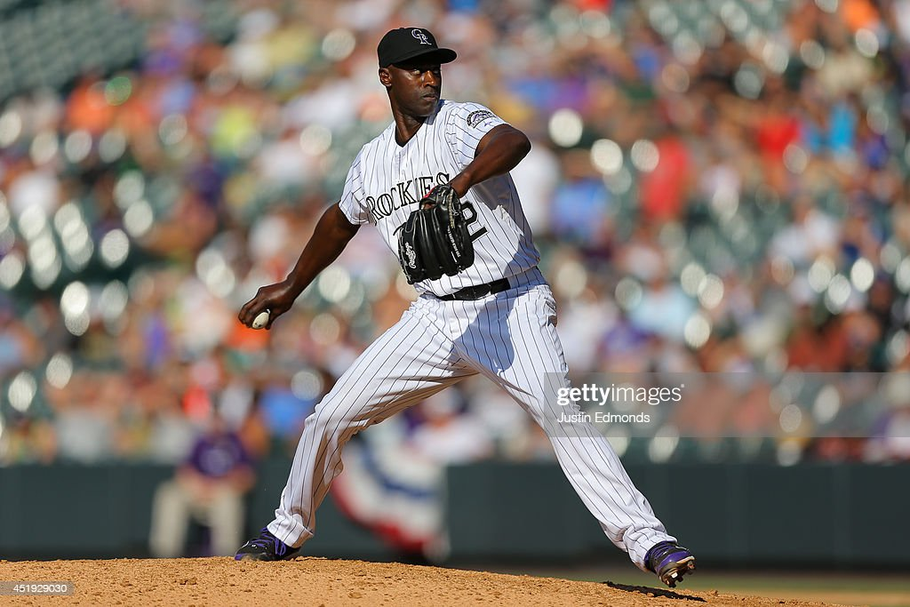 LaTroy Hawkins of the Colorado Rockies pitches against the Los Angeles Dodgers at Coors Field on July 5 2014 in Denver Colorado The Rockies defeated...