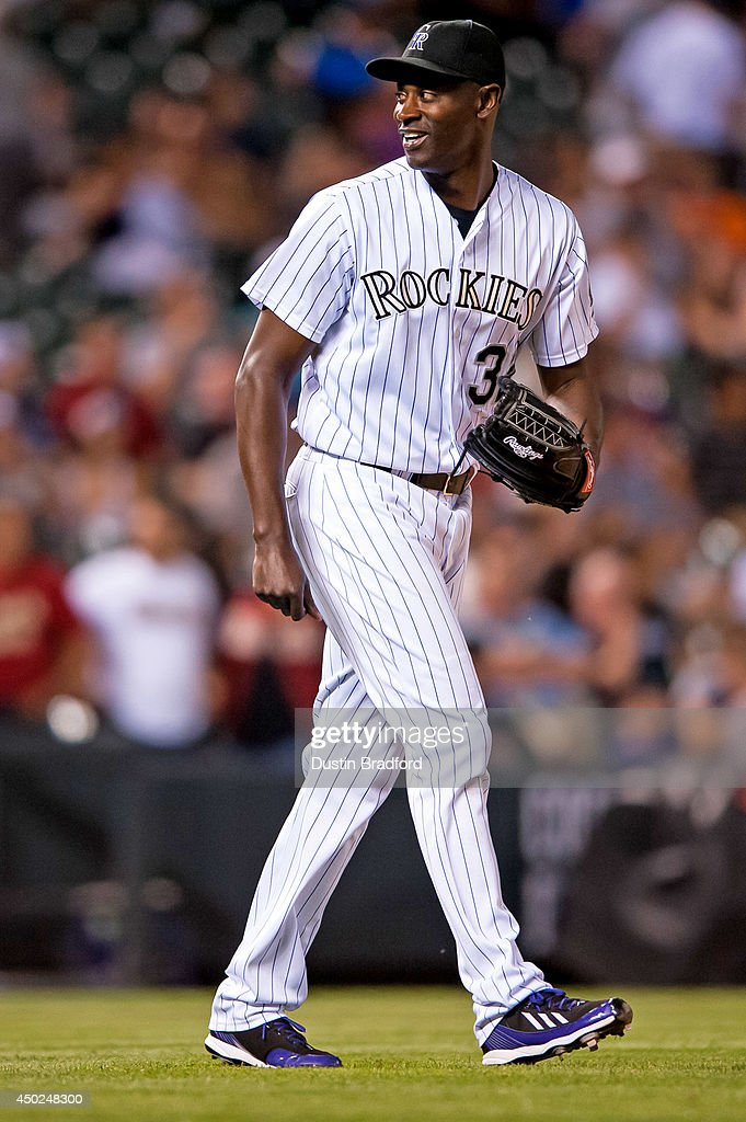 LaTroy Hawkins of the Colorado Rockies smiles as he prepares to face the Arizona Diamondbacks in the ninth inning of a game at Coors Field on June 3...