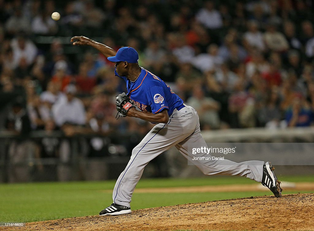 <a gi-track='captionPersonalityLinkClicked' href=/galleries/search?phrase=LaTroy+Hawkins&family=editorial&specificpeople=204722 ng-click='$event.stopPropagation()'>LaTroy Hawkins</a> #32 of the New York Mets pitches in the 9th inning against the Chicago White Sox at U.S. Cellular Field on June 25, 2013 in Chicago, Illinois. The White Sox defeated the Mets 5-4.