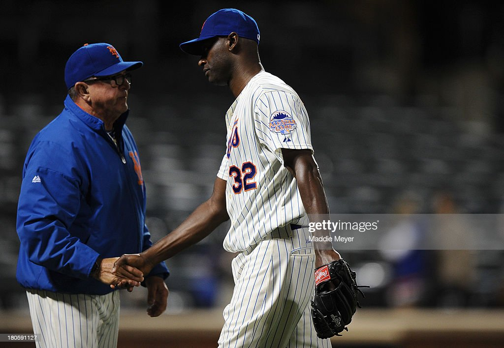 LaTroy Hawkins #32 of the New York Mets shakes hands with Dan Warthen #59 following game two of a doubleheader against the Miami Marlins on September 14, 2013 at Citi Field in the Flushing neighborhood of the Queens borough of New York City. The Mets defeated the Marlins 3-1.