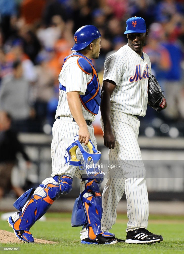 LaTroy Hawkins #32 of the New York Mets talks with teammate Travis d'Arnaud #15 after a win over the Miami Marlins 4-3 at Citi Field on September 13, 2013 in the Flushing neighborhood of the Queens borough of New York City.