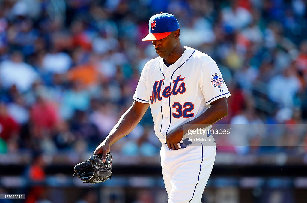 <a gi-track='captionPersonalityLinkClicked' href=/galleries/search?phrase=LaTroy+Hawkins&family=editorial&specificpeople=204722 ng-click='$event.stopPropagation()'>LaTroy Hawkins</a> #32 of the New York Mets walks to the dugout as he leaves a game in the ninth inning against the Detroit Tigers at Citi Field on August 25, 2013 in the Flushing neighborhood of the Queens borough of New York City.