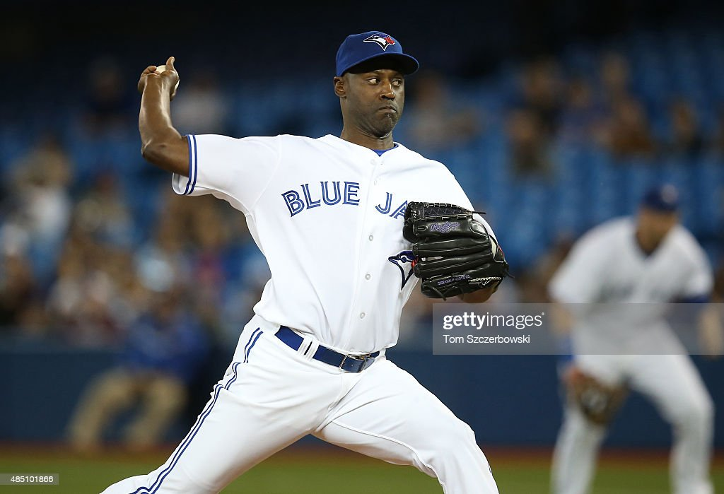 LaTroy Hawkins of the Toronto Blue Jays delivers a pitch in the ninth inning during MLB game action against the Minnesota Twins on August 5 2015 at...