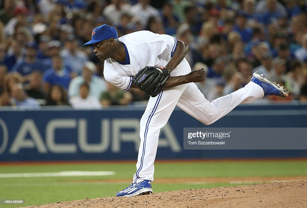 LaTroy Hawkins of the Toronto Blue Jays pitches in the seventh inning during an MLB game against the Kansas City Royals on July 30 2015 at Rogers...
