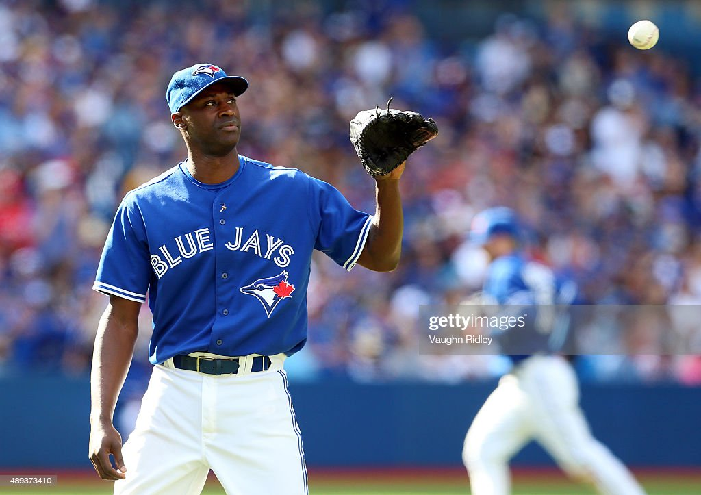 LaTroy Hawkins of the Toronto Blue Jays receives the ball in the ninth inning during a MLB game against the Boston Red Sox at Rogers Centre on...