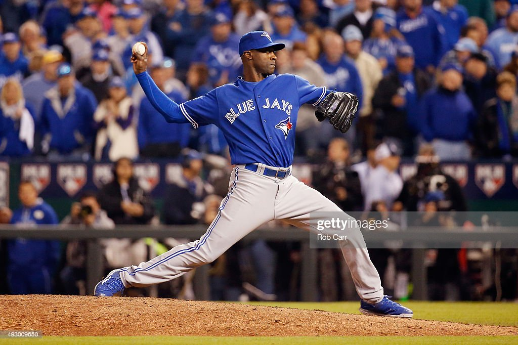 LaTroy Hawkins of the Toronto Blue Jays throws a pitch in the eighth inning against the Kansas City Royals during game one of the American League...