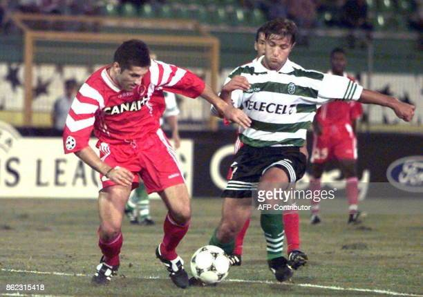 l'attaquant monégasque Robert Spehar tente de déborder le défenseur lisboate Pedro Martins le 17 septembre au stade Jose Albalade à Lisbonne lors de...