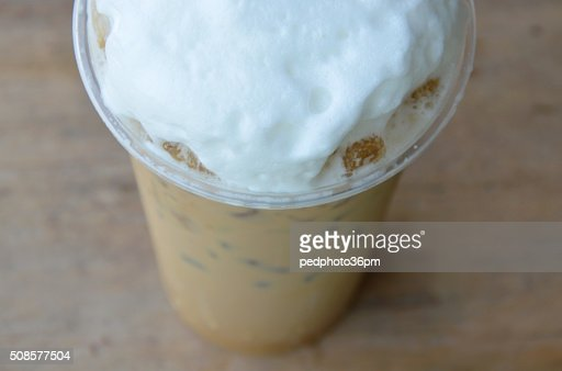 latte and milk froth in plastic cup : Stock Photo