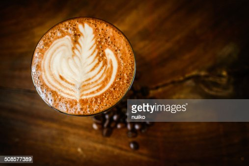 Latte art and coffee beans  on wooden : Stock Photo