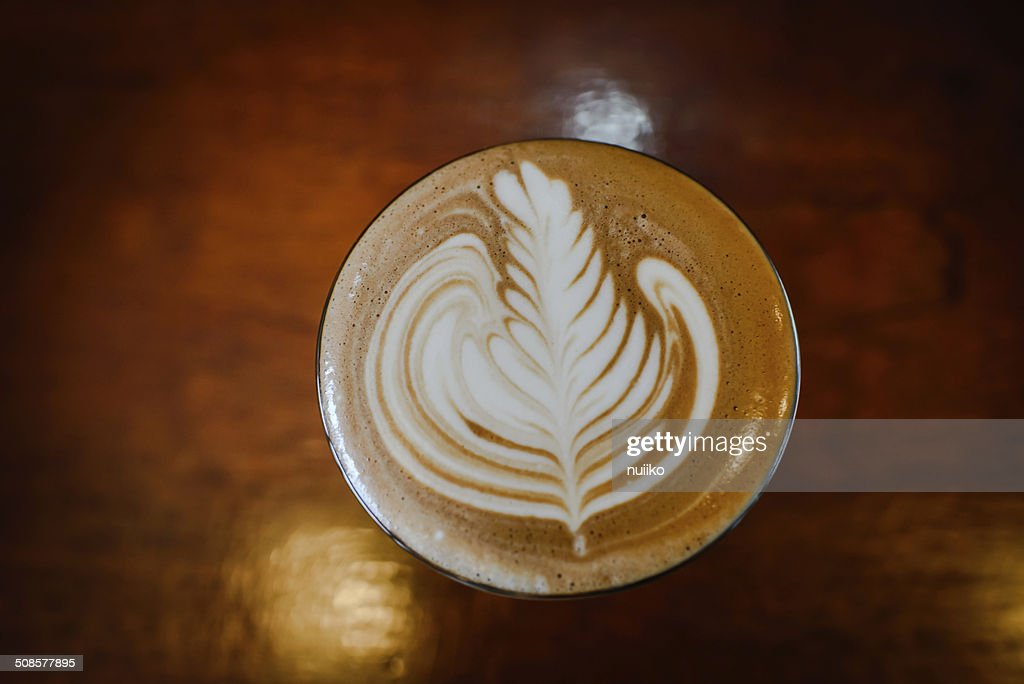 Latte art and coffee beans  on wooden : Stockfoto