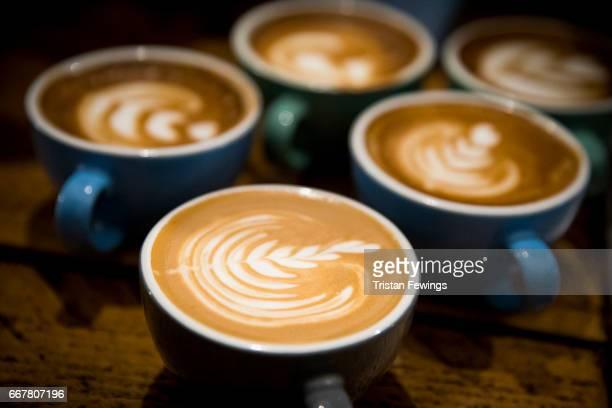 Latte art designs created at the Arla Organic Farm Milk Latte Art Throwdown at The Gentlemen Baristas on April 12 2017 in London United Kingdom Arla...
