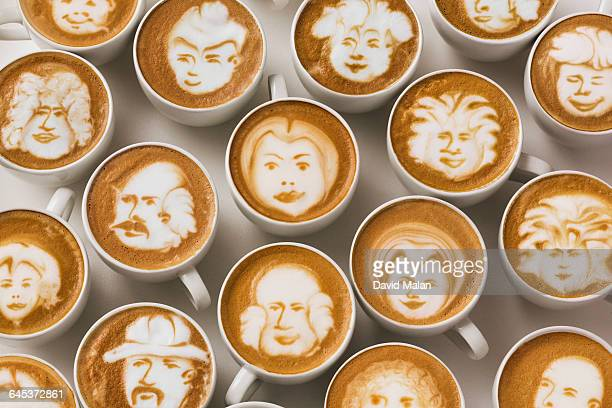 Latte art faces in cups of coffee