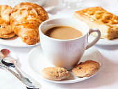 Cup of Latte Coffee with Chocolate Cookies and Butter Corissants