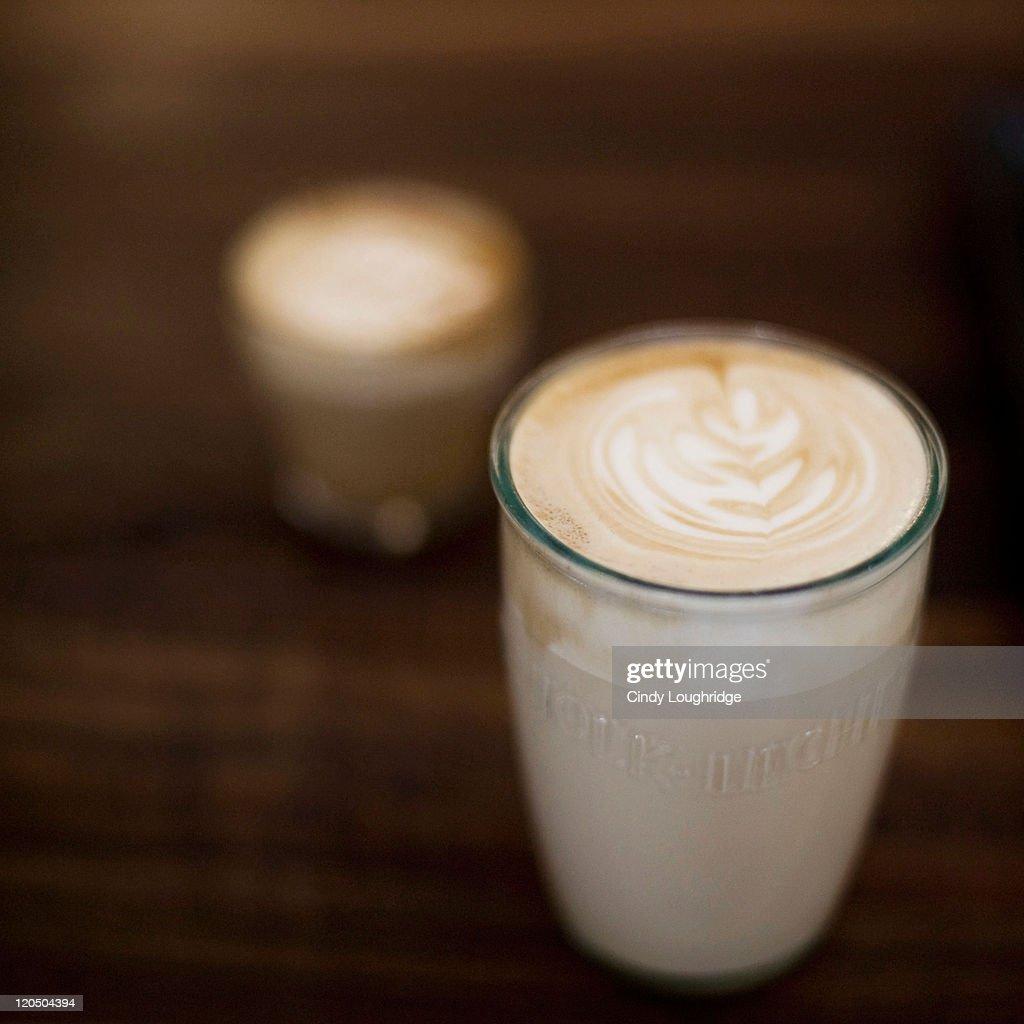 Latte in milk glass : Stock Photo