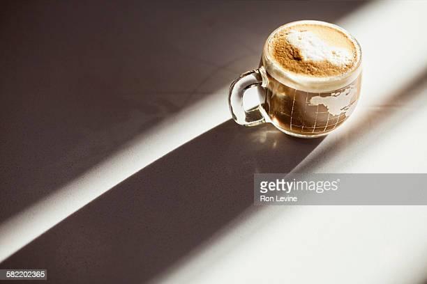 A latte served in a Globe cup