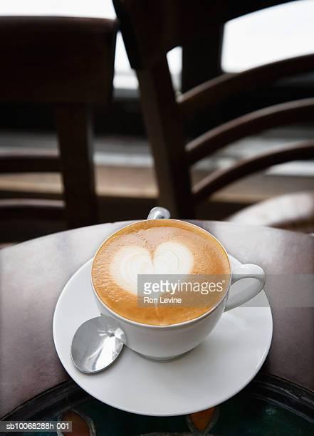Latte with heart design in foam, close-up