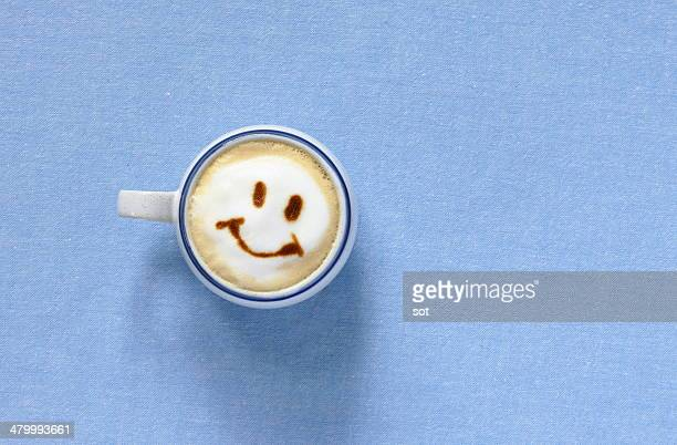 Latte with smiling face shaped foam,aerial view