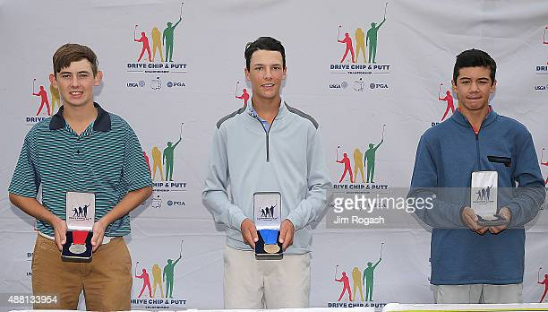 PJ Lattery placed second Ryan Levy placed first and Michael Thorbjornsen placed third in the in the Boys 1415 chipping competition as they pose with...