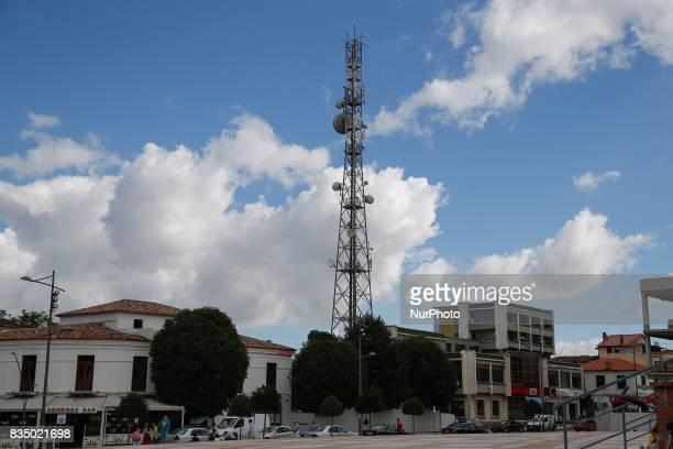 A lattice tower with broadcast antennas is seen in the center of Korce Albania on 28 July 2017