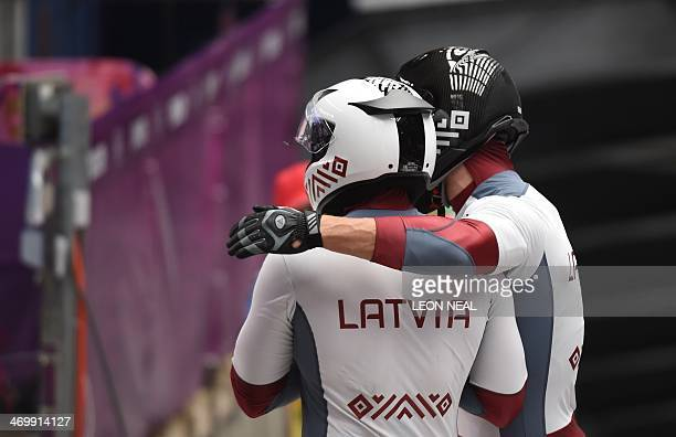 Latvia1 twoman bobsleigh pilot Oskars Melbardis gets a hug from brakeman Daumants Dreiskens at the end of their Bobsleigh Twoman Heat 3 at the...