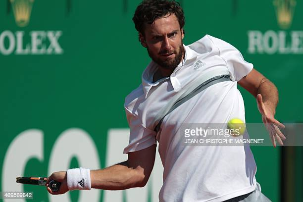 Latvian Ernests Gulbis hits a return to Austrian Andreas HaiderMaurerduring their tennis match of the MonteCarlo Masters Series Tournament on April...