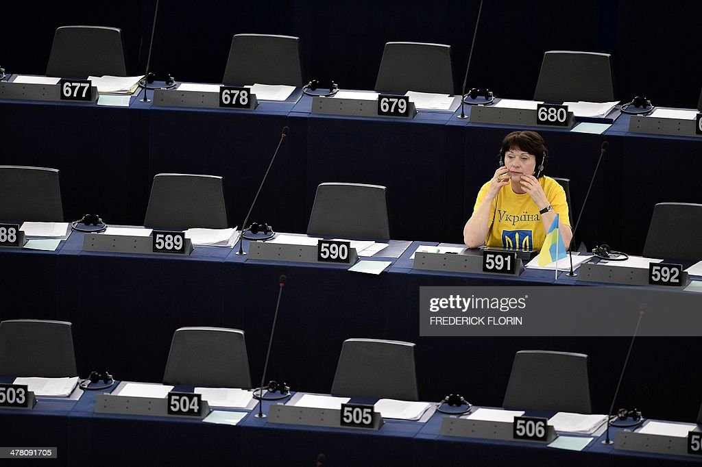 Latvian European MP Sandra Kalniete sits behind a Ukrainian flag during a plenary session at the European Parliament, on March 12, 2014 in Strasbourg, eastern France.