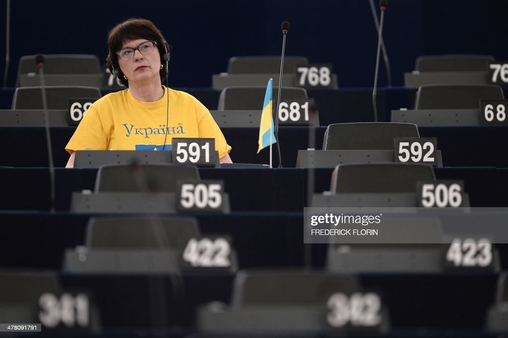 Latvian European MP Sandra Kalniete sits behind a Ukrainian flag during a debate on the Ukraine crisis as part of a plenary session at the European Parliament, on March 12, 2014 in Strasbourg, eastern France.