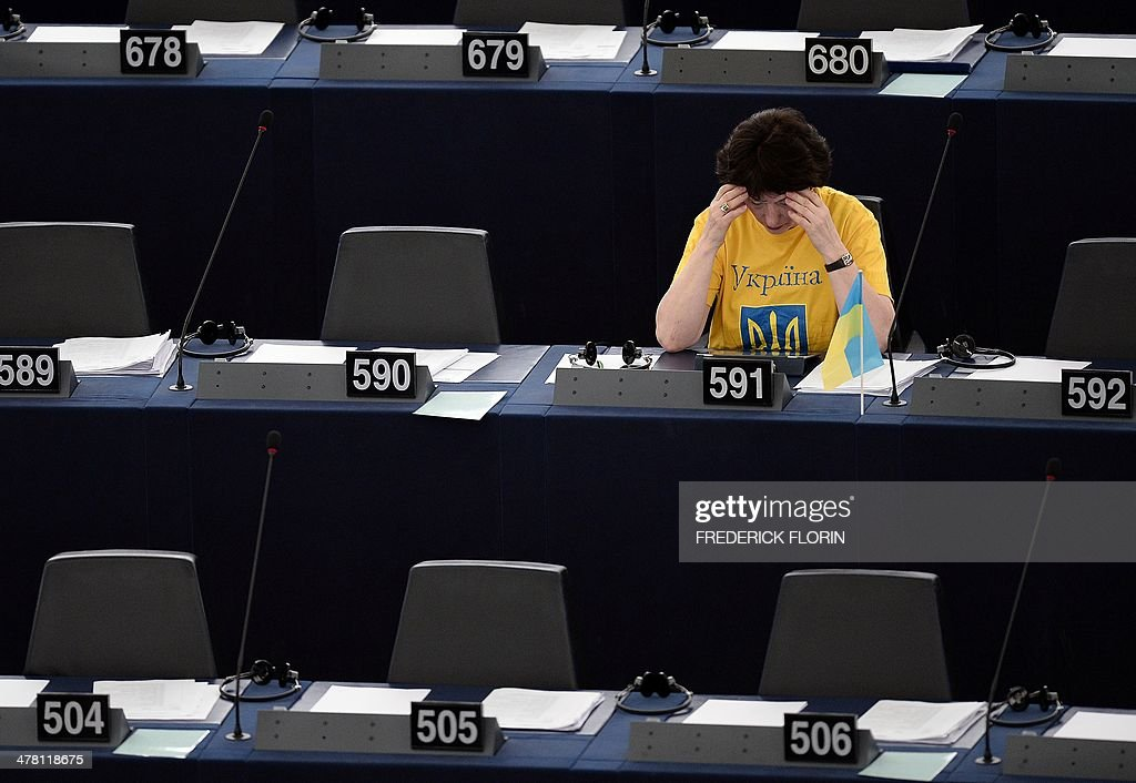 Latvian European MP Sandra Kalniete sits behind an Ukrainian flag during a plenary session at the European Parliament, on March 12, 2014 in Strasbourg, eastern France.