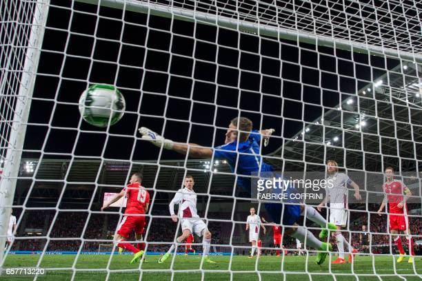 Latvian goalkeeper Andris Vanins fails to stop the match's only goal during the WC 2018 qualifying football match Switzerland vs Latvia on March 25...