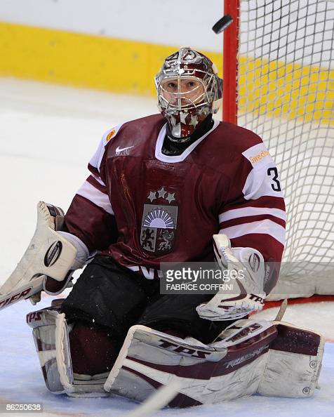 Latvian goalkeeper Edgars Masalskis watches the puck during during his Group C preliminary round game versus Sweden at the 2009 IIHF Ice Hockey World...