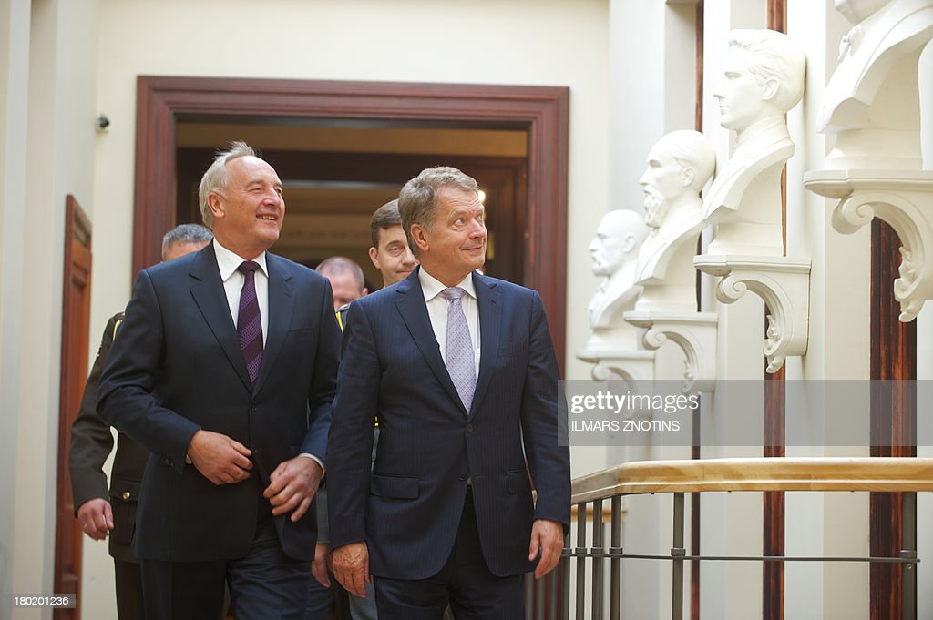 Latvian President Andris Berzins (L) and Finish counterpart Sauli Niinisto (R) walk before their meeting in Riga, Latvia, on September 10, 2013 before their meeting.