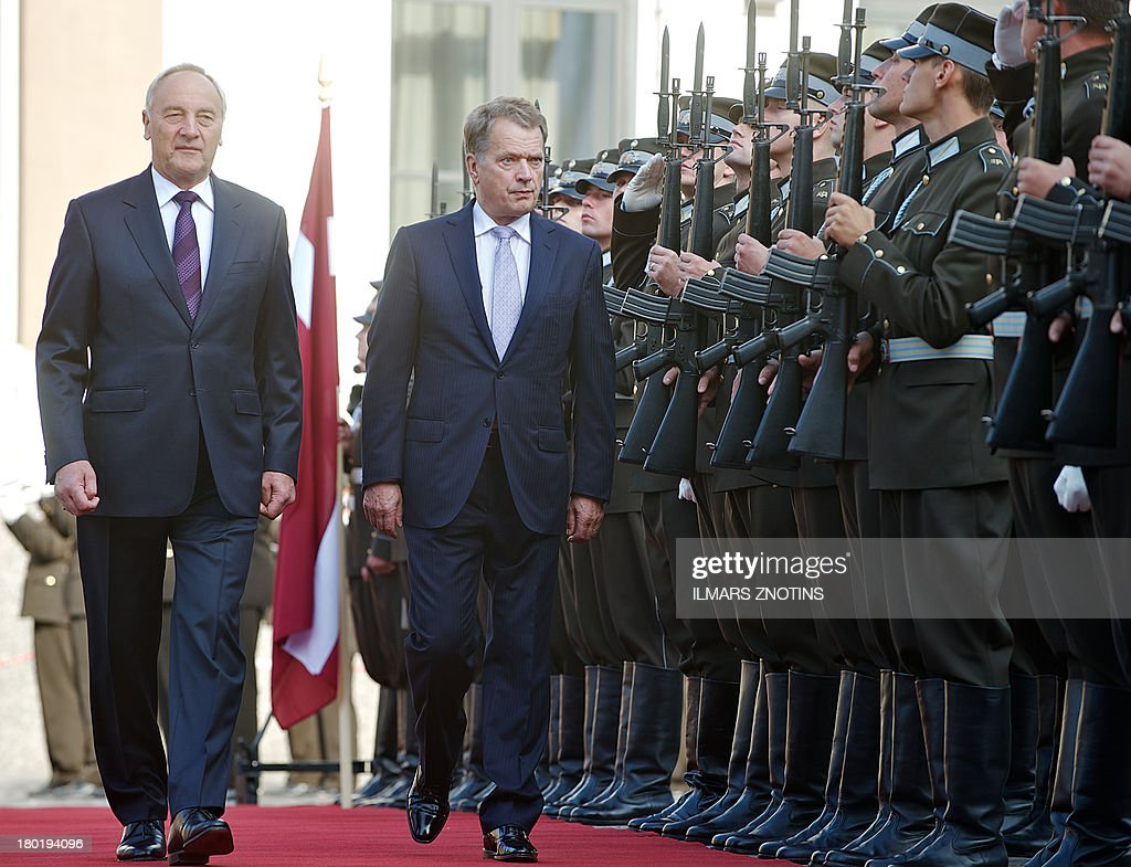 Latvian President Andris Berzins (L) and his Finish counterpart Sauli Niinisto (R) review a guard of honour in Riga, Latvia, on September 10, 2013 before their meeting. AFP PHOTO / ILMARS ZNOTINS
