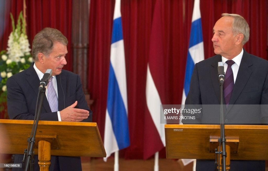 Latvian President Andris Berzins (R) and his Finish counterpart Sauli Niinisto (L) give a joint press conference after their meeting in Riga, Latvia, on September 10, 2013.