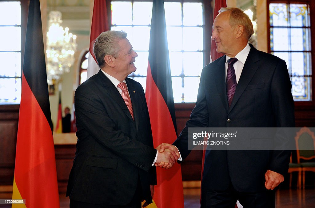 Latvian President Andris Berzins (R) and his German counterpart Joachim Gauck shake hands at the beginning of their meeting in Riga, Latvia, on July 7, 2013.
