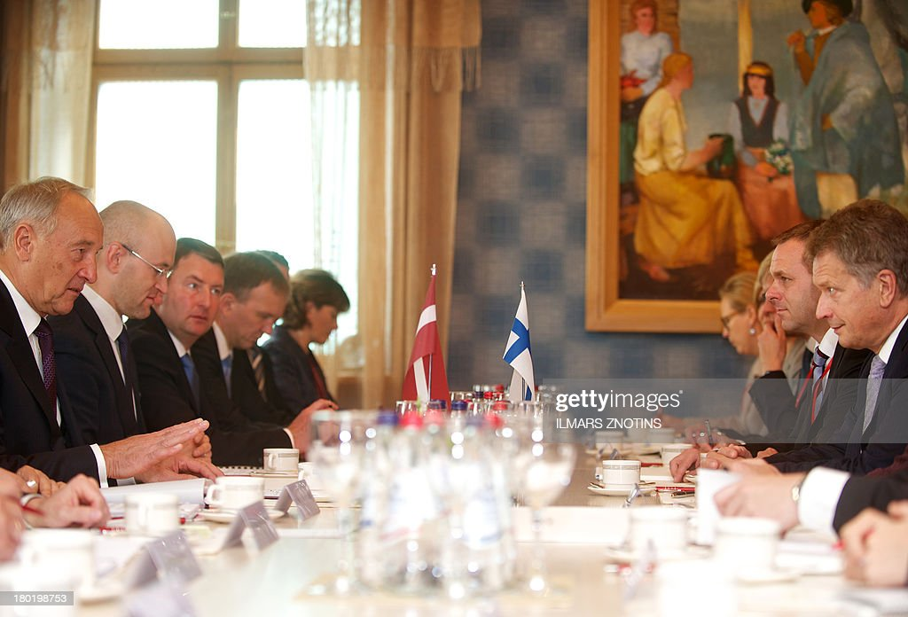 Latvian President Andris Berzins (L), his Finish counterpart Sauli Niinisto (R) and their delegation are seen at the start of their meeting in Riga, Latvia, on September 10, 2013.