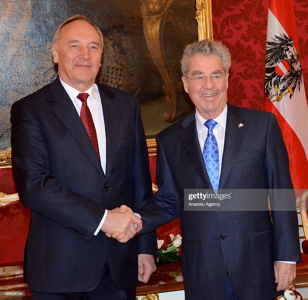 Latvian President Andris Berzins (L) shakes hand with Austrian President <a gi-track='captionPersonalityLinkClicked' href=/galleries/search?phrase=Heinz+Fischer&family=editorial&specificpeople=537198 ng-click='$event.stopPropagation()'>Heinz Fischer</a> (R) during his official visit in Vienna, Austria on April 8, 2015.