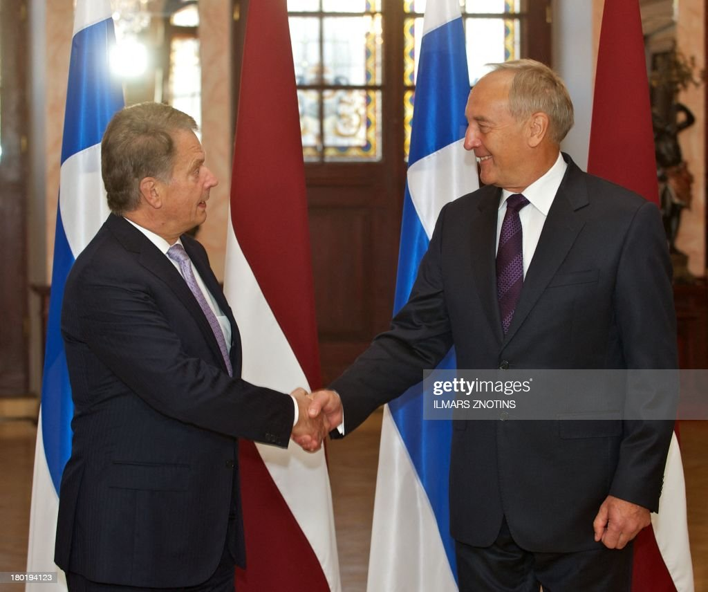 Latvian President Andris Berzins (R) shakes hands with his Finish counterpart Sauli Niinisto in Riga, Latvia, on September 10, 2013 before their meeting.