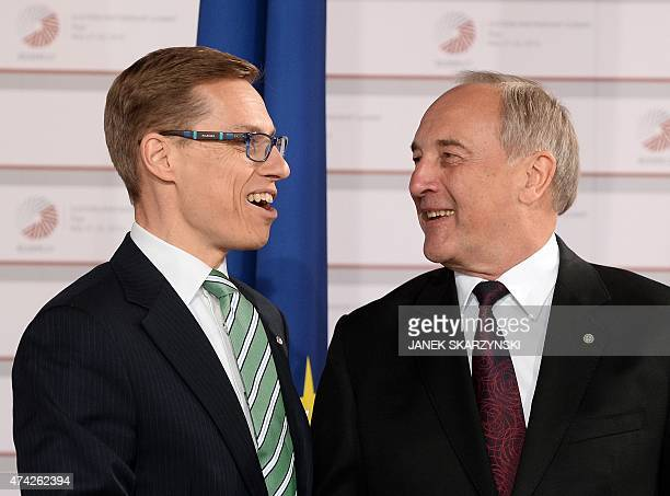 Latvian President Andris Berzins welcomes Finnish Prime Minister Alexander Stubb at the House of the Blackhead upon arrival for an informal dinner at...