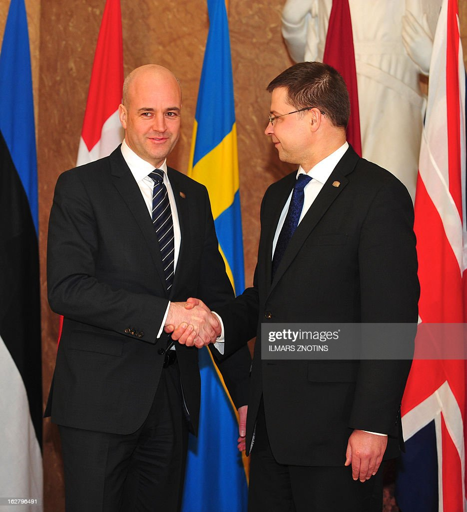Latvian Prime Minister Valdis Dombrovskis (R) shake hands with his Swedish counterpart Frederik Reinfeldt prior to the Northern Future Forum in Riga on February 27, 2013. The Northern Future Forum is an annual, informal meeting of prime ministers, policy innovators, entrepreneurs and business leaders from 9 nations.