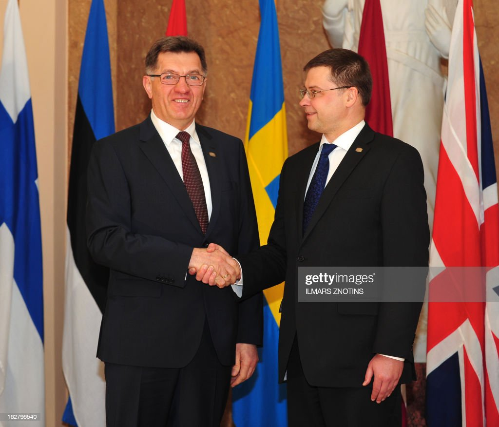 Latvian Prime Minister Valdis Dombrovskis (R) shake hands with his Lithuanian counterpart Algirdas Butkevicius prior to the Northern Future Forum in Riga on February 27, 2013. The Northern Future Forum is an annual, informal meeting of prime ministers, policy innovators, entrepreneurs and business leaders from 9 nations.