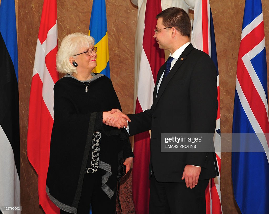 Latvian Prime Minister Valdis Dombrovskis (R) shake hands with his Icelandic counterpart Johanna Sigurdardottir prior to the Northern Future Forum in Riga on February 27, 2013. The Northern Future Forum is an annual, informal meeting of prime ministers, policy innovators, entrepreneurs and business leaders from 9 nations.